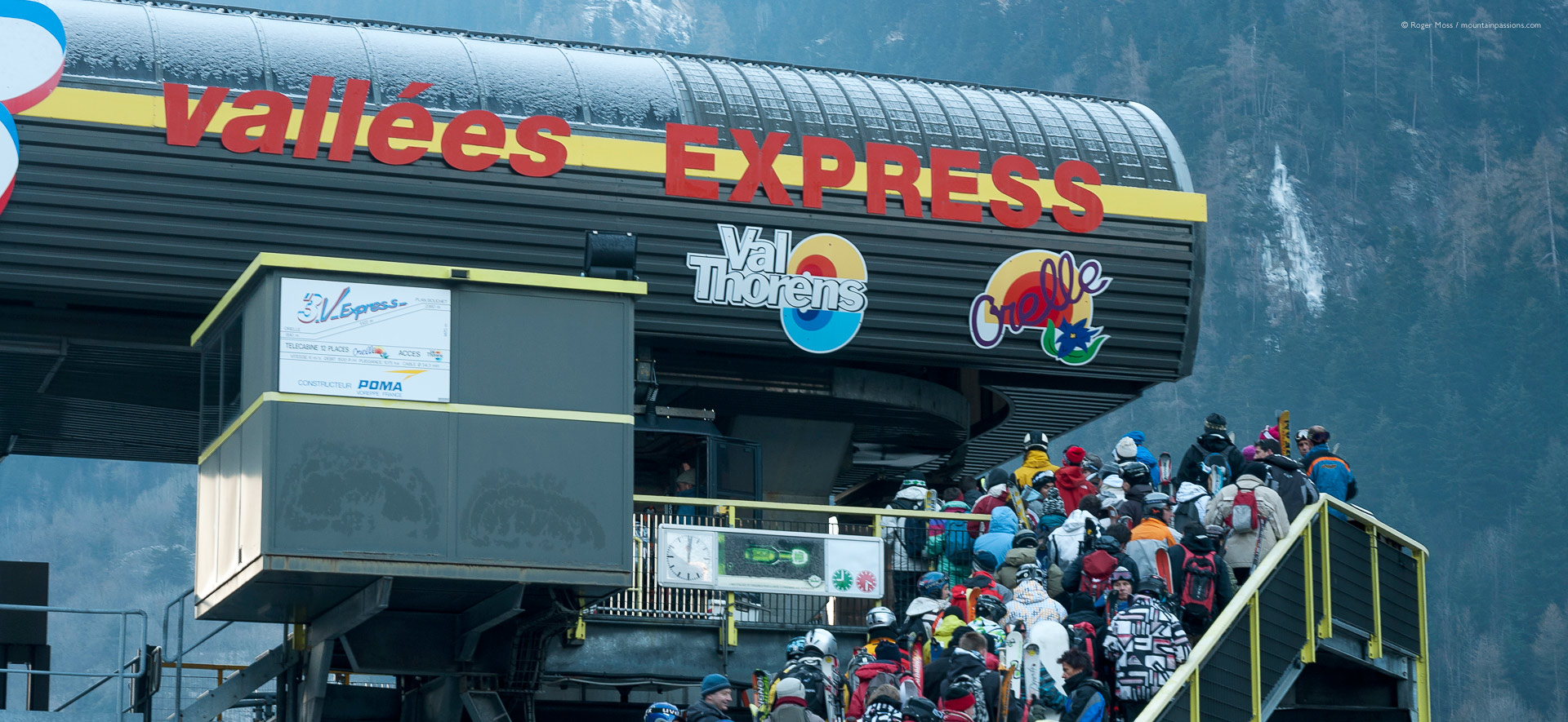 Skiers queueing to board gondola lift