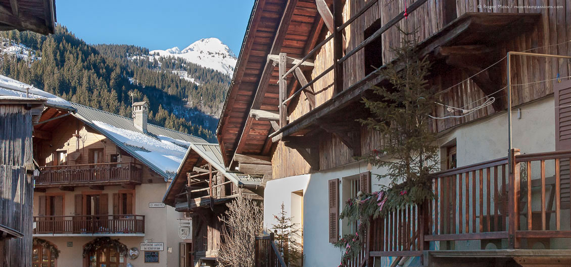 Traditional Savoyard chalets in Areches village, with snow-covered mountains