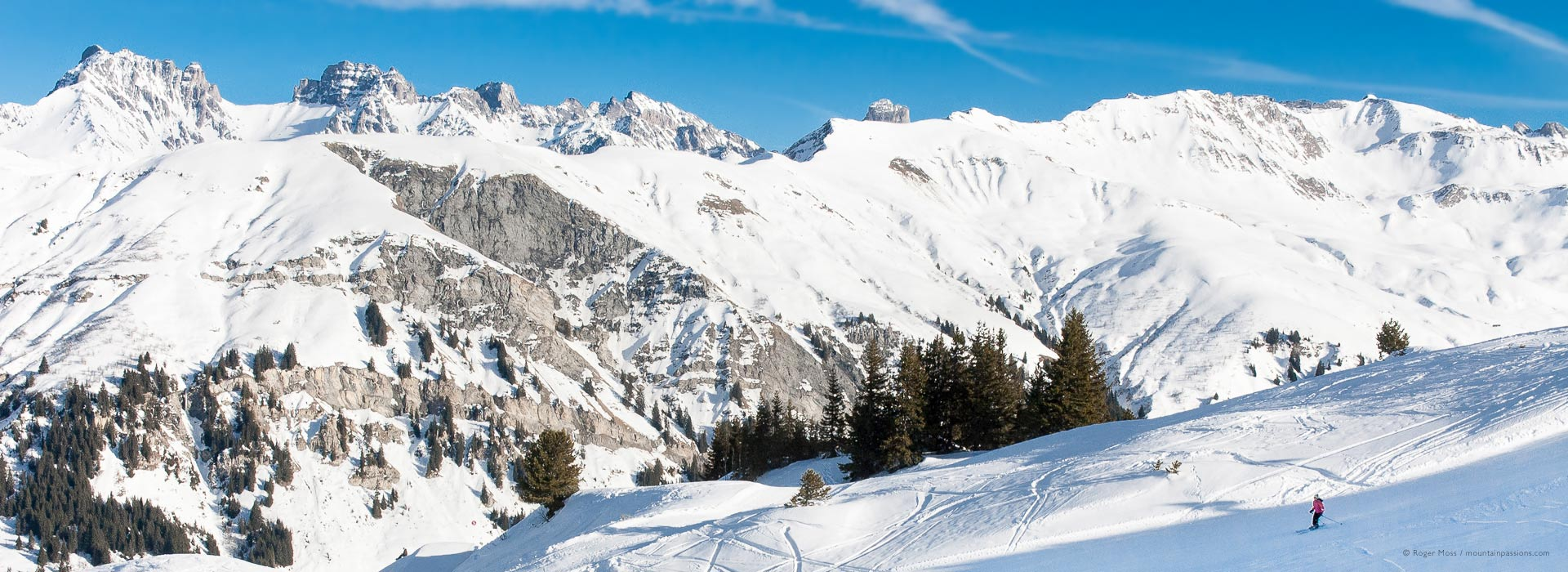 Wide view of skier on piste above Arêches-Beaufort ski resort