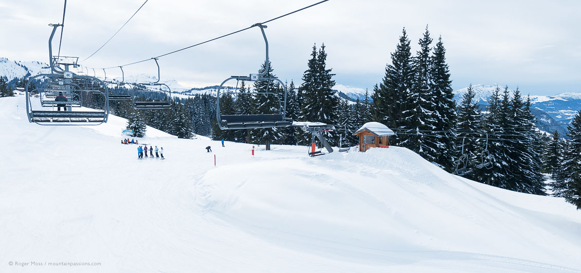Chair lift view of mountainside with skiers at Morzine