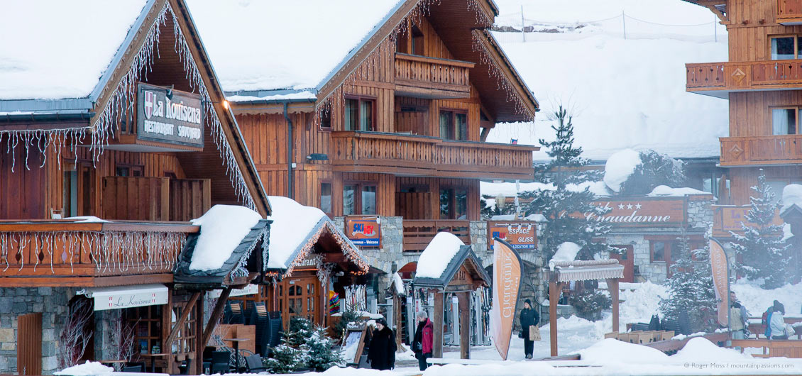 Visitors among ski boutique and hotels at Meribel