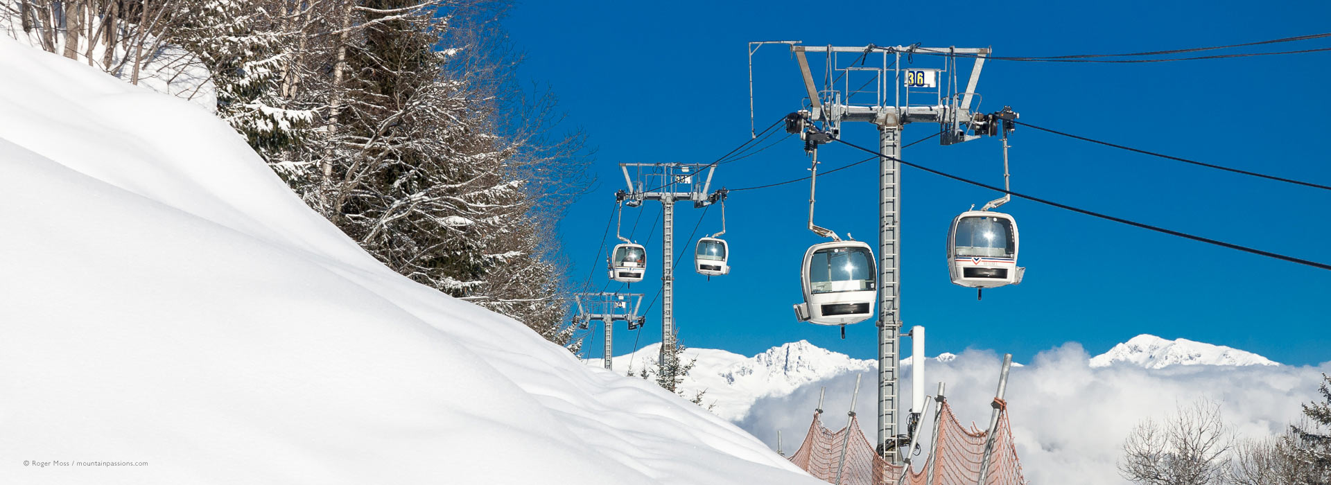 Olympe gondola lift from Brides-les-Bains, with fresh snow at Meribel..