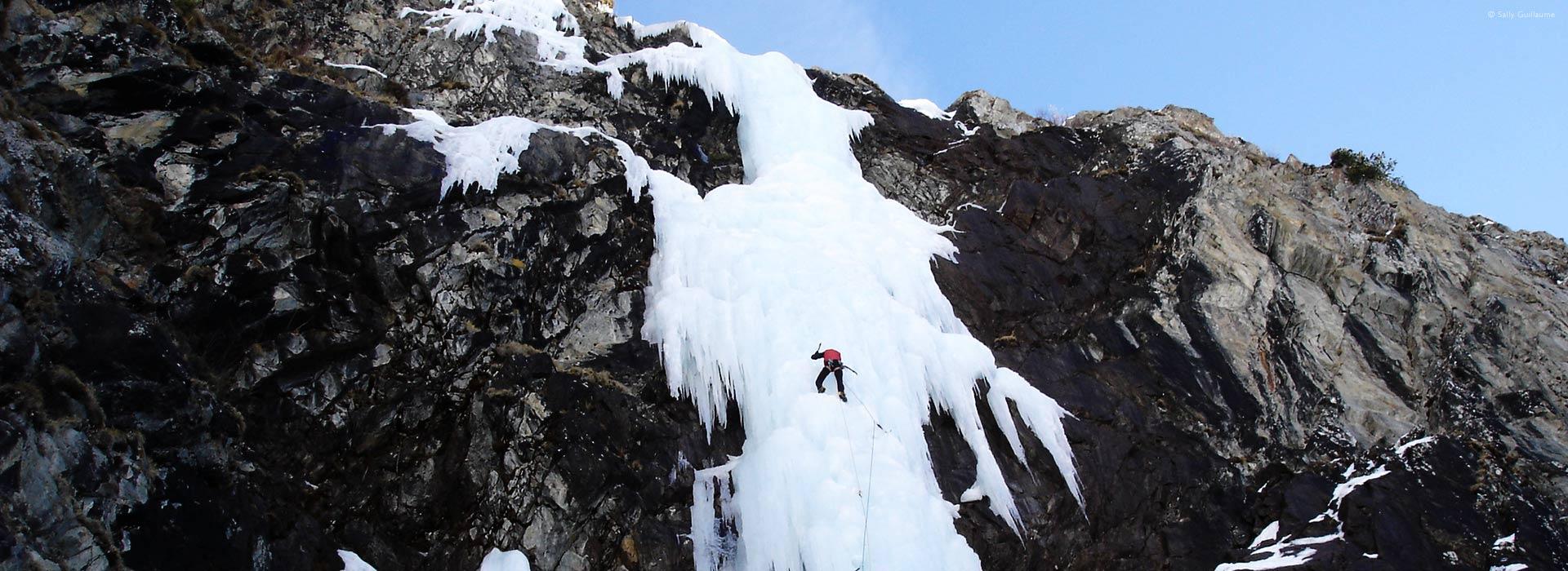 ice-climbing on frozen waterfall