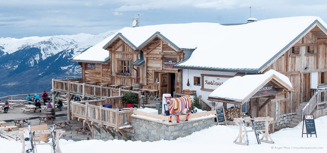 Overview of chalet-style mountain restaurant at Les Arcs