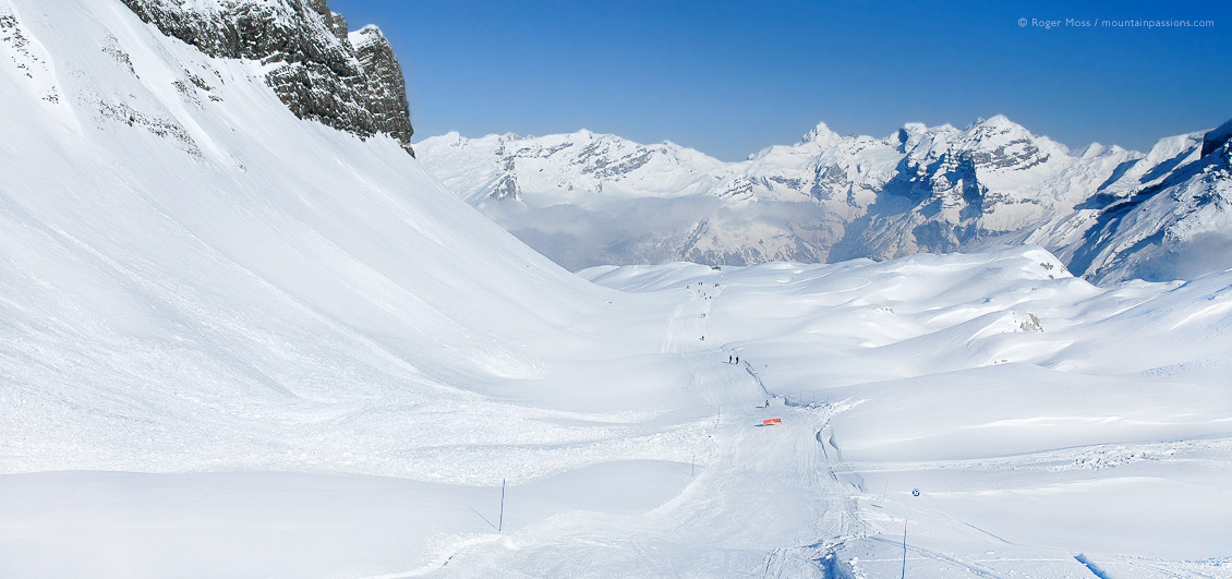 Wide valley with distant skier in huge mountain landscape above Flaine, Grand Massif