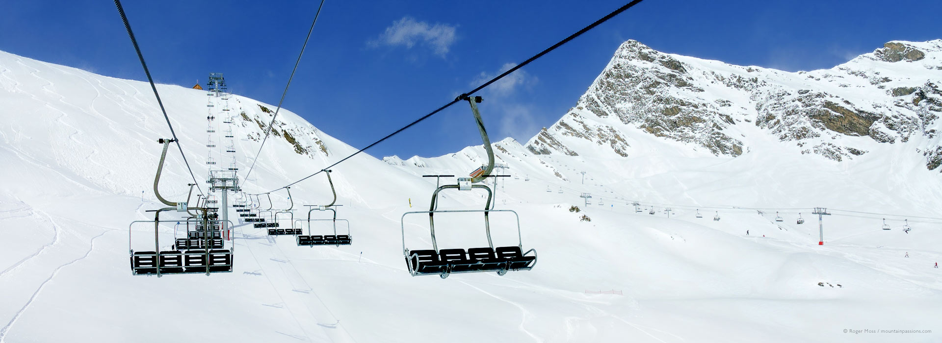 Wide view from chairlift of mountains above Cauterets ski resort.