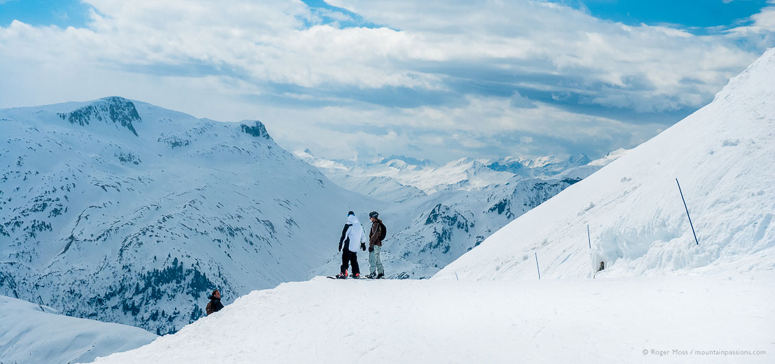 Two snowboarders with big mountain view at Les Contamines