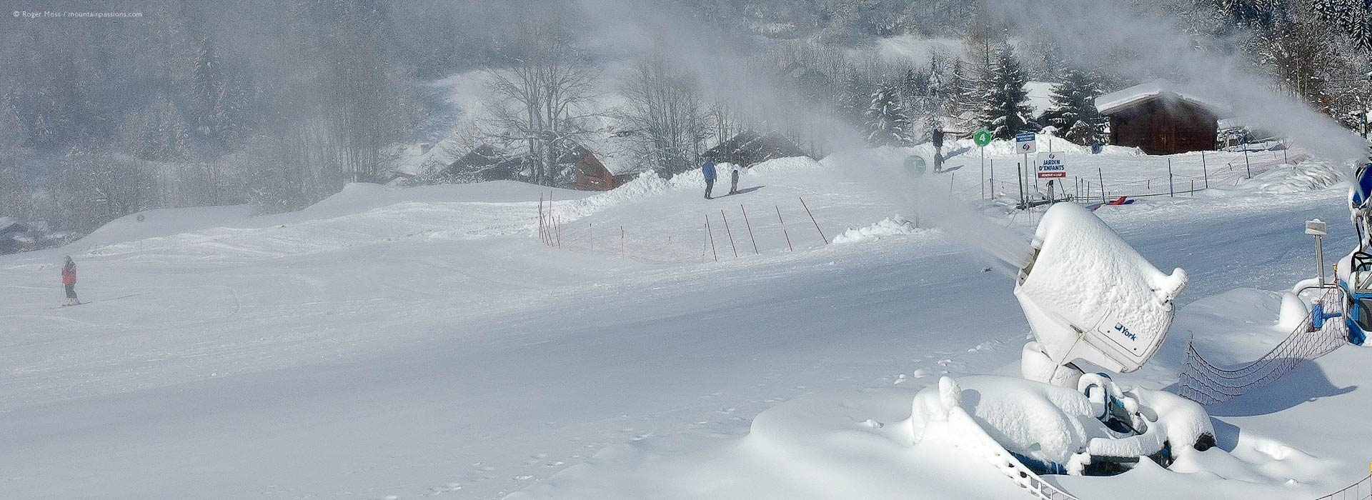 Artificial snowmaking beside ski piste at Sixte-Fer-A-Cheval, Grand Massif ski area, French Alps.