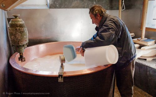 Jean-Pierre Blanc checking temperature of milk in copper vat