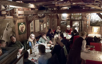 High interior view of traditional Savoyard restaurant with diners