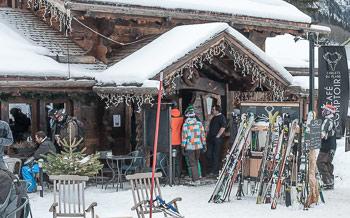 Skiers entering Le Comptoir restaurant at Vallorcine ski village, Chamonix Valley, French Alps.