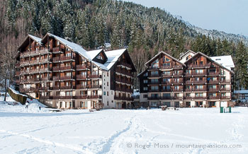 View across snow to Balcons du Savoy chalet-style apartments