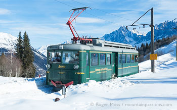 Mont-Blanc Tramway car on snow-covered mountainside at Les Houches