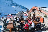 Skiers on the terrace, La Tane Ô Marmottes, Plaine Dranse, Châtel