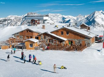 Skiers and chalets, Les Menuires, Three Valleys, French Alps