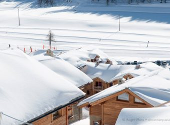 The Obelisque area accommodation rooftops with snow, Montgenevre, French Alps