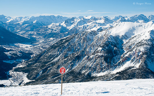 From Le Chalvet (2630m) Briançon appears far below, dwarfed still further by the dramatic backdrop of les Briançonnais mountains.