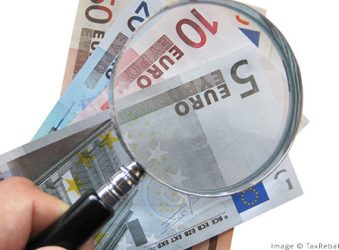euros with magnifying glass