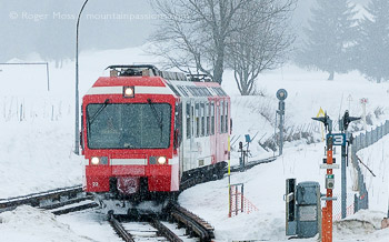 Mont-Blanc Express train arriving at Vallorcine with falling snow
