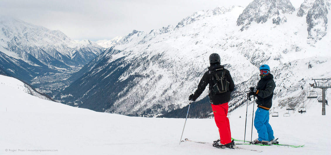 Wide view of two skiers from Vallorcine with overview of Chamonix Valley
