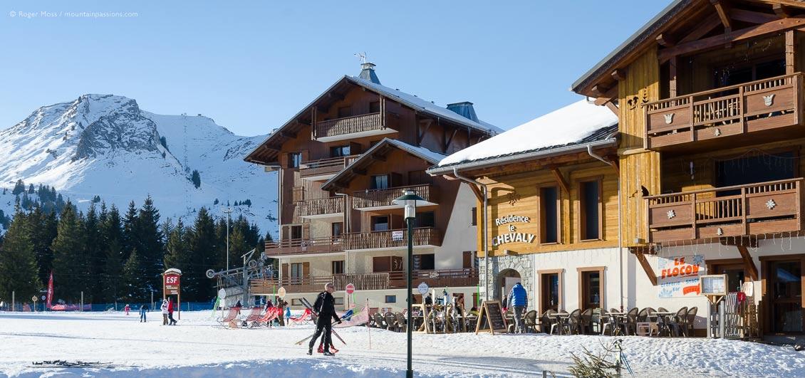 Wide view of front de neige, Praz de Lys ski village, French Alps.