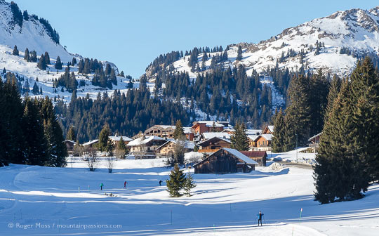 Long view of Praz de Lys ski village, with cross country skiers