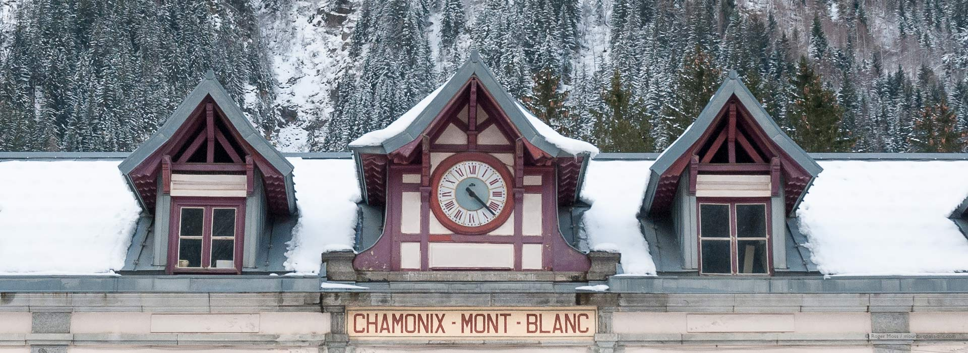 Snow-covered roof of Chamonix Mont-Blanc Gare SNCF, French Alps.