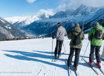 Group of skiers overlooking the Chamonix Valley, French Alps.