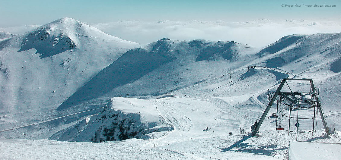 Wide view of ski pistes and draglift at Le Mont Dore, Auvergne, France