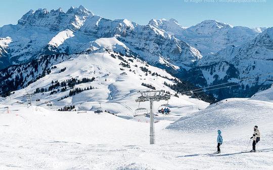 Overview of two skiers descending mountainside at Les Crozets, Portes du Soleil