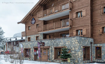 Exterior view in snow of CGH Les Chalets de Layssia ski apartments, Samoens, French Alps