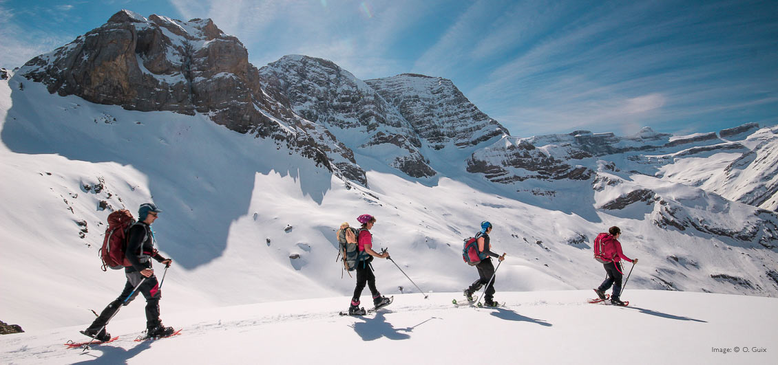 Group on a guided snowshoe walk, French Pyrenees. Image © O.Guix