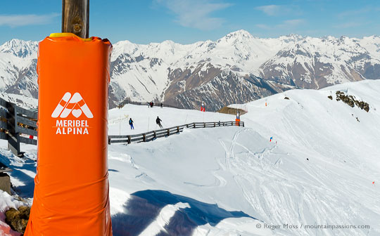 View of two skiers with mountains above Meribel