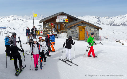 Group of skiers beside mountain rescue point