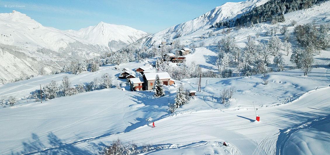 View of snowboarder on ski piste above Saint Martin de Belleville