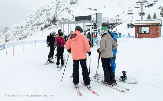 ski-lift with skiers at Les 7 Laux
