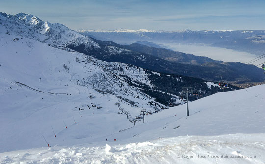 wide view of early morning ski piste and mountains