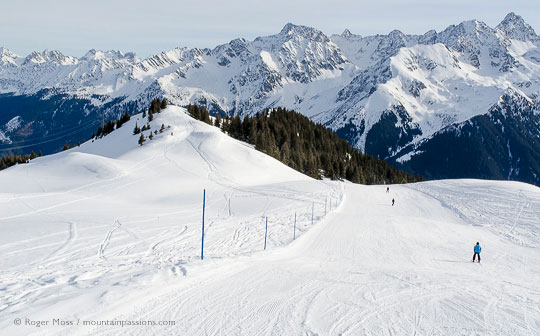 High view of skiers on wide piste