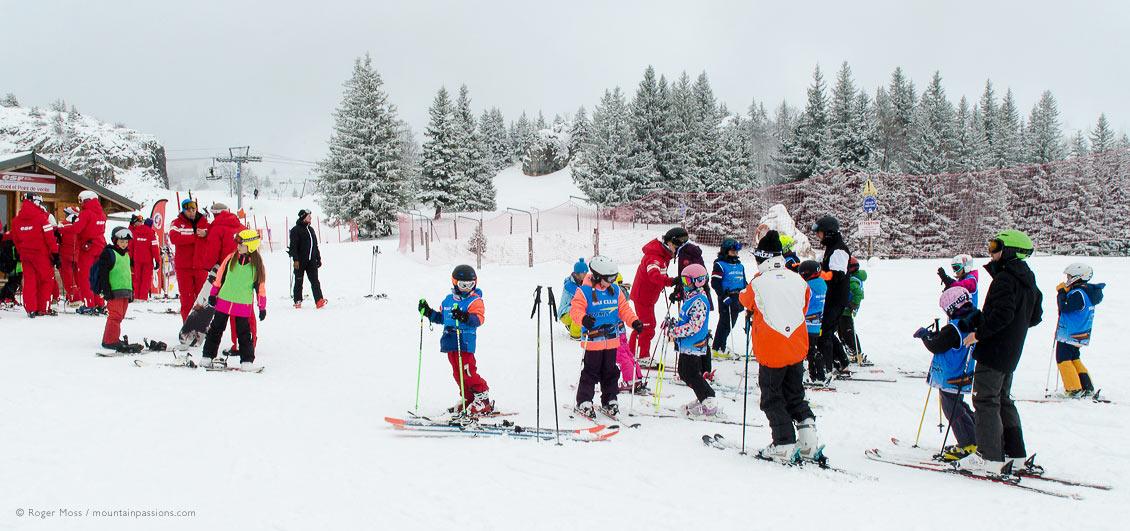 Families gathering at ski school on mountains at Villard de Lans
