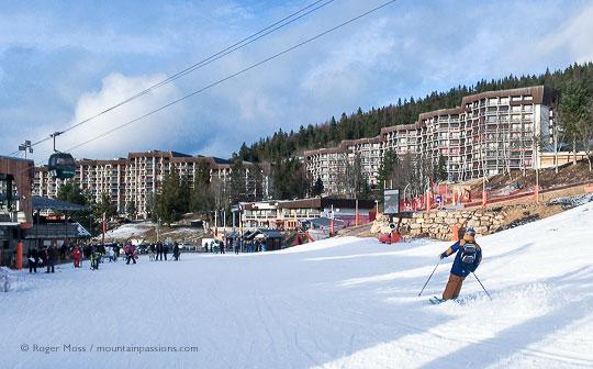 Skier returning to Cote 2000 village