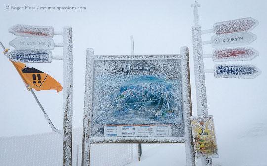 View through mist of frozen piste signage